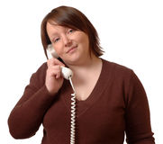 Woman on phone. Woman on the phone, on white background royalty free stock photography