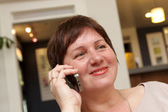 Woman with phone Royalty Free Stock Photography