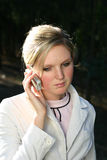 Woman on phone. Young woman holding mobile phone Stock Photo