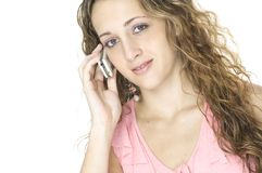 Woman On Phone. A beautiful young female talks on a cellphone Stock Image