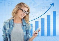 Woman with phone against blue graph. Digital composite of Woman with phone against blue graph Stock Images