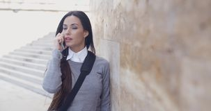 Woman on phone with atonished expression stock footage
