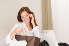 Woman on phone - back home from shopping Royalty Free Stock Photography