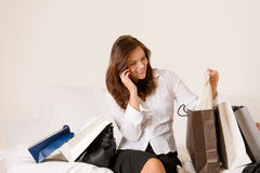 Woman on phone - back home from shopping Royalty Free Stock Image