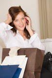 Woman on phone - back home from shopping Royalty Free Stock Photos