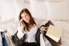 Woman on phone - back home from shopping Royalty Free Stock Images