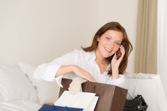 Woman on phone - back home from shopping Stock Photography