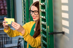 Woman with phone on the balcony Stock Image