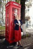 Woman at  phone box Royalty Free Stock Photo