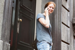 Woman on the Phone before a Building Royalty Free Stock Photo