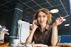 Woman with phone in cafe Stock Photos