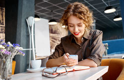 Woman with phone in cafe Royalty Free Stock Photos