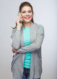 Woman phone call. Smiing young woman isolated. Royalty Free Stock Photo