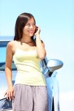 Woman on phone by car stock image