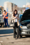 Woman on the phone after car crash Stock Image