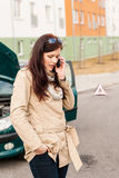 Woman on the phone for car help Royalty Free Stock Images