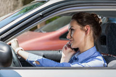Woman on phone in car Stock Image