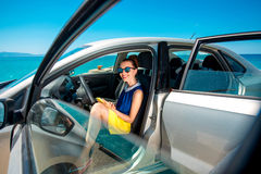 Woman with phone in the car Stock Photography