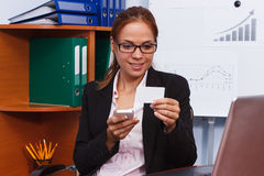 Woman with the phone and card in the hands, business concept Royalty Free Stock Images