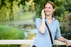 Woman on the Phone in a City Park Royalty Free Stock Image