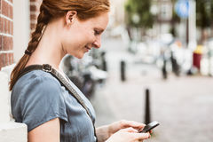 Woman with Phone in a City Royalty Free Stock Photos