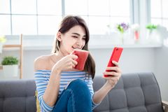 Woman with phone and coffee royalty free stock photography