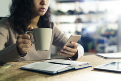 Woman with phone and coffee Stock Image