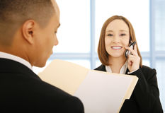 Woman On The Phone With Coworker Royalty Free Stock Images