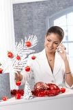 Woman on phone decorating for christmas Royalty Free Stock Images