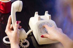 Woman phone dialing Stock Image