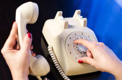 Woman phone dialing Royalty Free Stock Photography