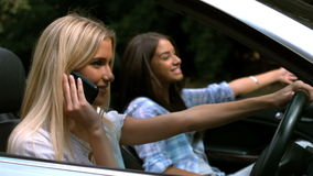 Woman on the phone while driving stock video footage