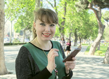 Woman with the phone Stock Image
