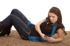Woman phone floor sad Royalty Free Stock Photo