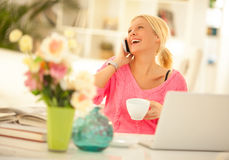 Woman on the Phone at Home Stock Photography