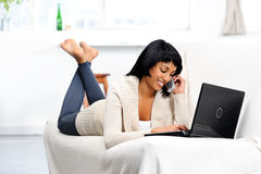 Woman with phone and laptop Stock Image
