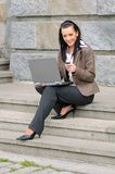 Woman with phone and laptop Stock Photography