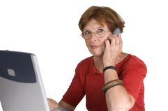 Woman on phone with laptop Royalty Free Stock Images
