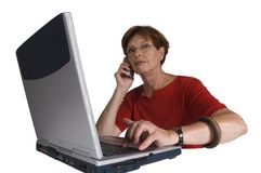 Woman with phone and laptop Stock Images