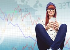 Woman with phone and legs crossed against blue graph Stock Photography