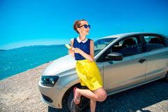 Woman with phone near the car Royalty Free Stock Photo