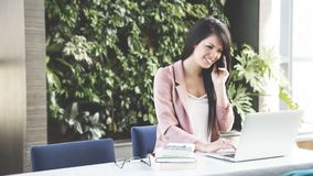 Woman on phone in office Royalty Free Stock Image