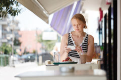 Woman with phone in outdoor cafe Royalty Free Stock Photo