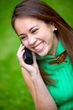 Woman on the phone outdoors Stock Images
