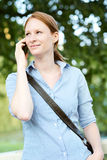 Woman on the Phone in a Park Royalty Free Stock Photos
