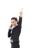 Woman on the phone pointing up Royalty Free Stock Photo