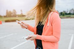 Woman with phone and power bank playing the mobile games Stock Photography
