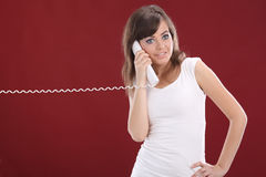 Woman on Phone . red background Stock Image