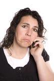 Woman on phone sad Stock Images