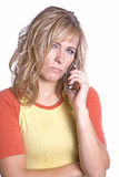 Woman on phone scowling Royalty Free Stock Photos